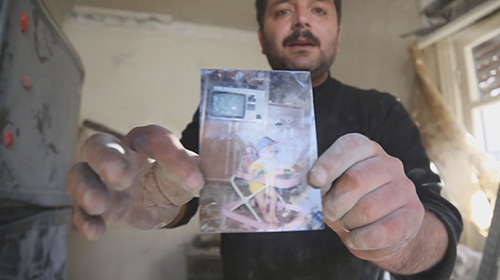 Syria War Documentary Film Man Holding Photo of His Daughter