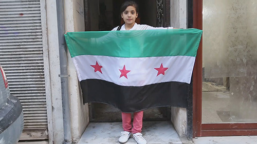 Syria War Documentary Film Subject Nasma Holding A Flag