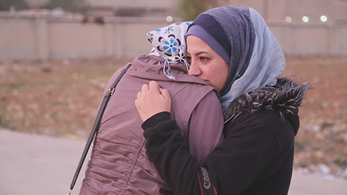 Syria War Documentary Film Subject Nour Crying With Her Friend